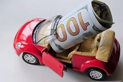 Billete de banco y coche rojo Fotos de archivo