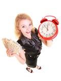 Billete de banco y despertador del dinero del pulimento de la tenencia de la mujer Imagen de archivo libre de regalías