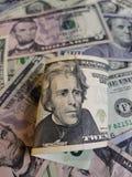 billete de banco y fondo de 20 dólares con los billetes de banco del dólar Foto de archivo