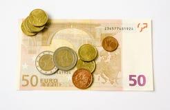 Billete de banco y monedas euro Imagen de archivo libre de regalías