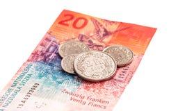 Billete de banco y monedas suizos Fotografía de archivo libre de regalías