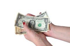 Billete de dólar en la mano femenina Foto de archivo libre de regalías