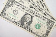 1 billete de dólar en un fondo blanco Fotografía de archivo