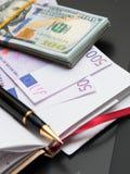 Billetes, cuaderno, manija fotos de archivo libres de regalías