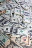 Billetes de banco americanos del dólar muchas cuentas de los billetes de banco Fotos de archivo libres de regalías