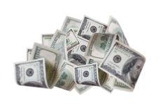 Billetes de banco apilados del dólar que vuelan Foto de archivo libre de regalías