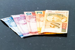 Billetes de banco brasileños de los reais Foto de archivo libre de regalías