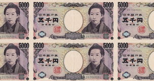 Billetes de banco de cinco mil balanceos japoneses de los yenes en la pantalla, dinero del efectivo, lazo metrajes