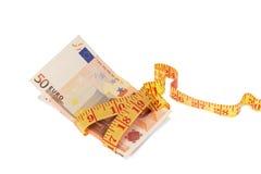 Billetes de banco de la cinta métrica y del euro Fotografía de archivo libre de regalías