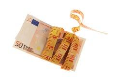 Billetes de banco de la cinta métrica y del euro Foto de archivo libre de regalías
