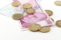 Billetes de banco de la lira turca y dinero del hierro Imágenes de archivo libres de regalías
