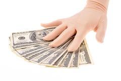 Billetes de banco de los dólares de la explotación agrícola de la mano Fotografía de archivo