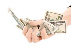 Billetes de banco de los dólares de la explotación agrícola de la mano Fotos de archivo