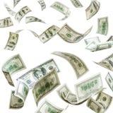 Billetes de banco de los dólares que caen aislados Imagen de archivo