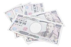 Billetes de banco de los yenes japoneses en el fondo blanco Imagen de archivo libre de regalías