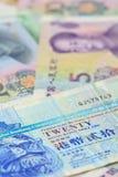 Billetes de banco de Yuan del dólar y del chino de Hong-Kong, para el concepto del dinero Fotos de archivo libres de regalías