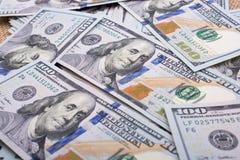 Billetes de banco del dólar de EE. UU. separados alrededor Foto de archivo libre de regalías