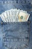 Billetes de banco del dólar en bolsillo de la parte posterior de los vaqueros Fotografía de archivo libre de regalías