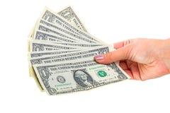 Billetes de banco del dólar en mano femenina Imágenes de archivo libres de regalías