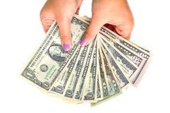 Billetes de banco del dólar en mano femenina Imagen de archivo
