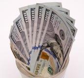 Billetes de banco del dólar en taza Imágenes de archivo libres de regalías