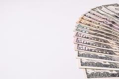 Billetes de banco del dinero de los E.E.U.U. en el fondo blanco Imagen de archivo