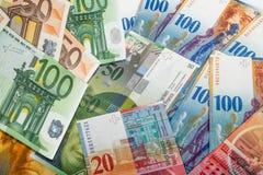 Billetes de banco del suizo y de la UE Imágenes de archivo libres de regalías