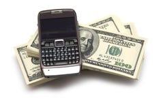 Billetes de banco del teléfono y del dólar Imágenes de archivo libres de regalías