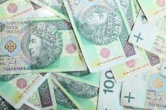 billetes de banco del zloty del pulimento 100's como fondo del dinero Fotos de archivo libres de regalías