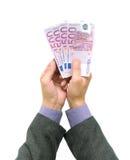 Billetes de banco en las manos de hombres Foto de archivo libre de regalías