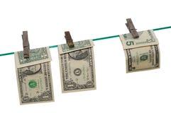 Billetes de banco en una línea de ropa Fotos de archivo