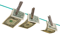 Billetes de banco en una línea de ropa Fotografía de archivo libre de regalías