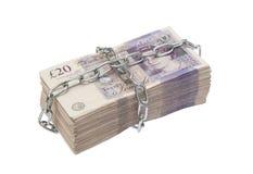 Billetes de banco encadenados Imagenes de archivo