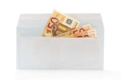 Billetes de banco euro en sobre en un blanco Fotos de archivo libres de regalías