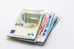 Billetes de banco euro sobre blanco Imagen de archivo libre de regalías