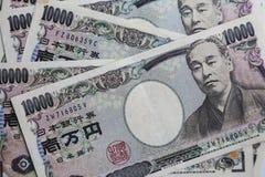 Billetes de banco japoneses, 10 000 yenes Imágenes de archivo libres de regalías
