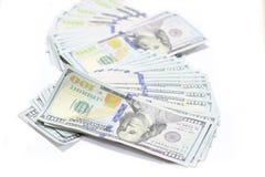 Billetes de banco de las cuentas de dólar de EE. UU. con el fondo blanco Imagen de archivo