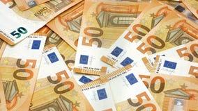 50 billetes de banco o cuentas euro alfombran la cantidad giratoria 4k almacen de metraje de vídeo