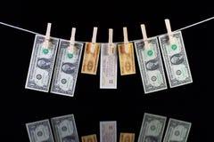 Billetes de banco sucios del dólar de EE. UU. y de China Foto de archivo libre de regalías