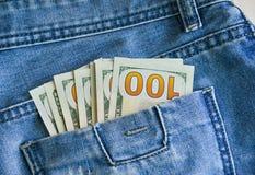 Billetes de banco USD del dólar americano en el bolsillo fotos de archivo