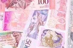 Billetes de banco viejos de diversos pa?ses ex?ticos Fondo colorido de los billetes Macro del primer imagen de archivo