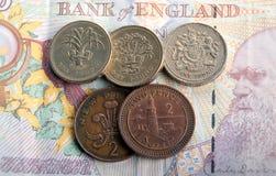Billetes de banco y monedas Imágenes de archivo libres de regalías