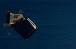 Billetes de banco y monedas de la cartera Imagen de archivo