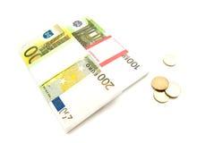 Billetes de banco y monedas de los euros Foto de archivo libre de regalías