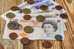 Billetes de banco y monedas del Reino Unido imagen de archivo