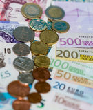 Billetes de banco y monedas esterlinas y euro Foto de archivo libre de regalías