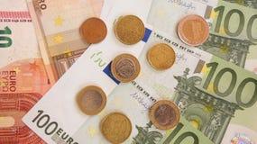 Billetes de banco y monedas euro Imagen de archivo
