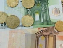 Billetes de banco y monedas euro Foto de archivo libre de regalías