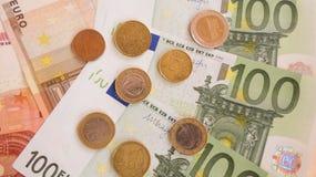 Billetes de banco y monedas euro Imagenes de archivo