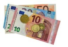 Billetes de banco y monedas euro Aislado con el fichero del png atado Fotos de archivo libres de regalías